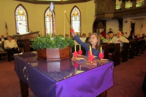 The first candle of Advent is lighted in morning worship