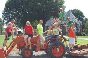 Camp participants posing on the tractor